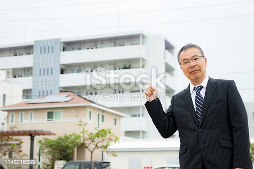 891418990 istock photo An elderly businessman. Business person with gray hair. 1146218399