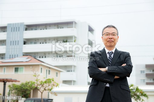 891418990 istock photo An elderly businessman. Business person with gray hair. 1146218777