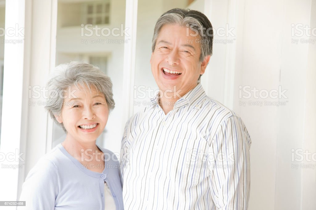 老夫婦が笑っています。 ストックフォト