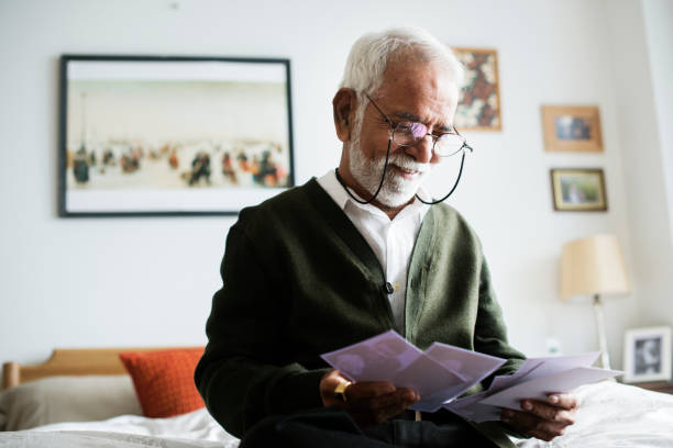 An elderly Indian man at the retirement house stock photo
