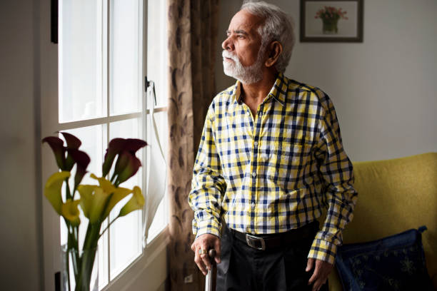An elderly Indian man at the retirement house An elderly Indian man at the retirement house one man only stock pictures, royalty-free photos & images
