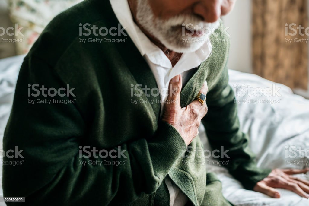An elderly Indian man with heart problems stock photo
