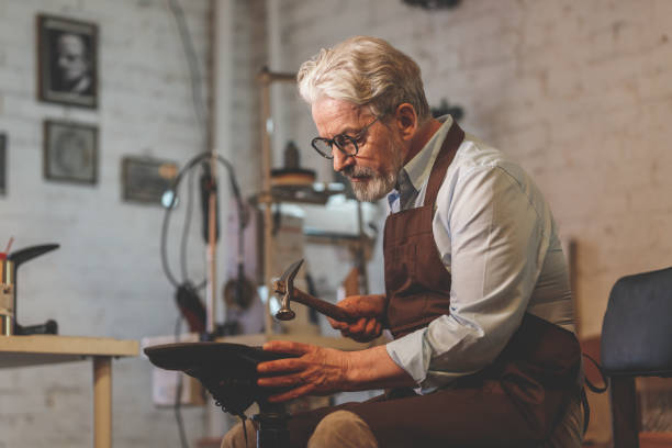 An elderly man at work stock photo