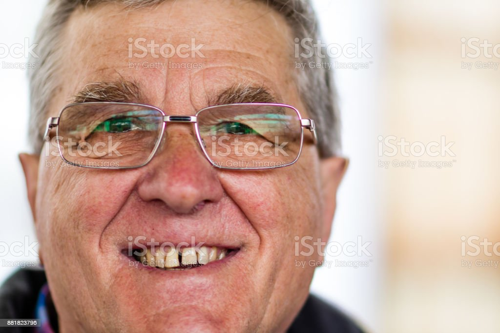 An elderly man smiling at the camera stock photo