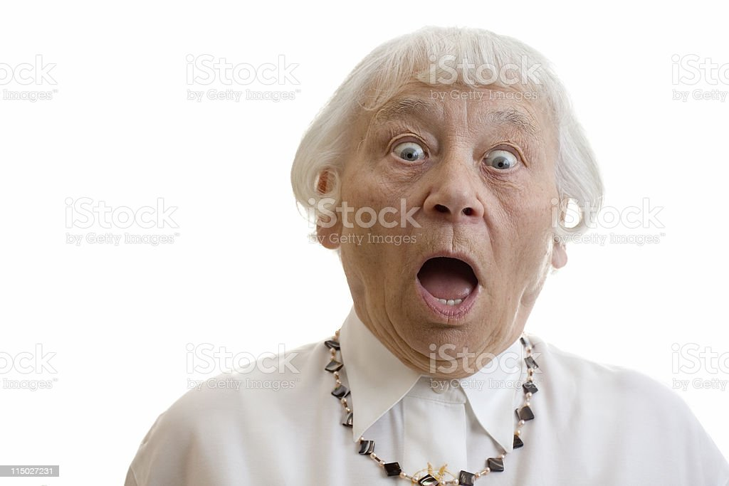 An elderly person opening their eyes and mouth in shock stock photo