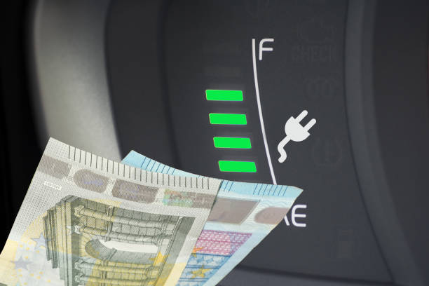 An electric car and Euro banknotes stock photo