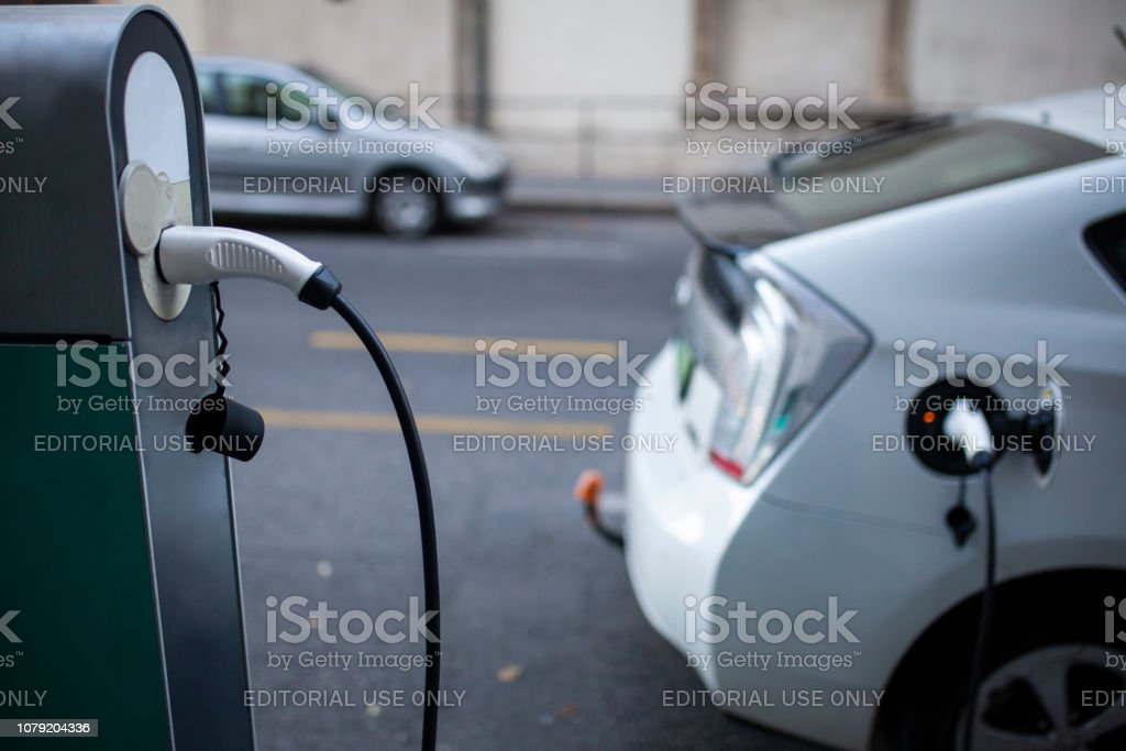Electric car is charging on buda street, Hungary