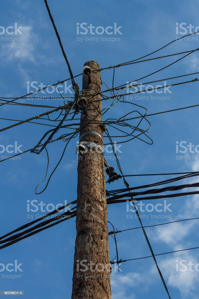 an electric pole with wires stock photo