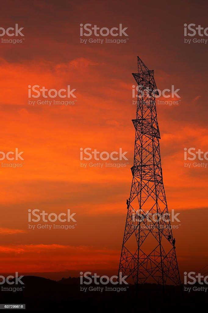 An electric pylon in evening sun stock photo