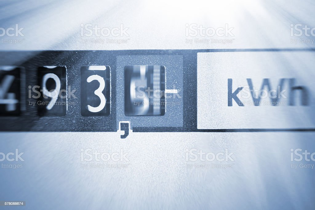 An electricity meter measures the current consumed stock photo