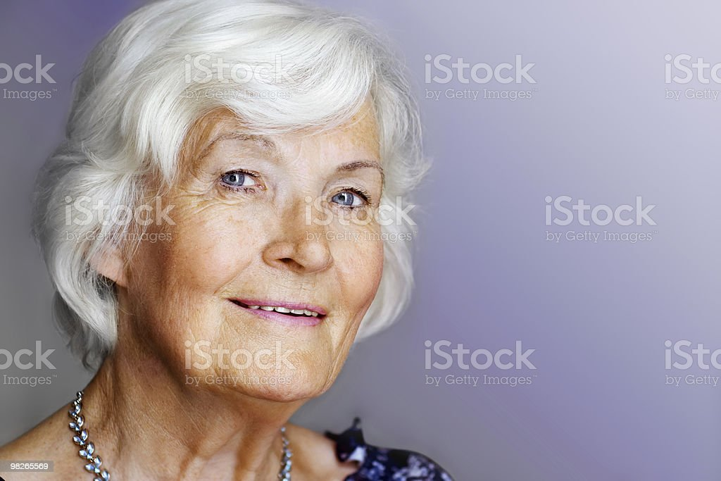 An elegant stylish elderly female royalty-free stock photo