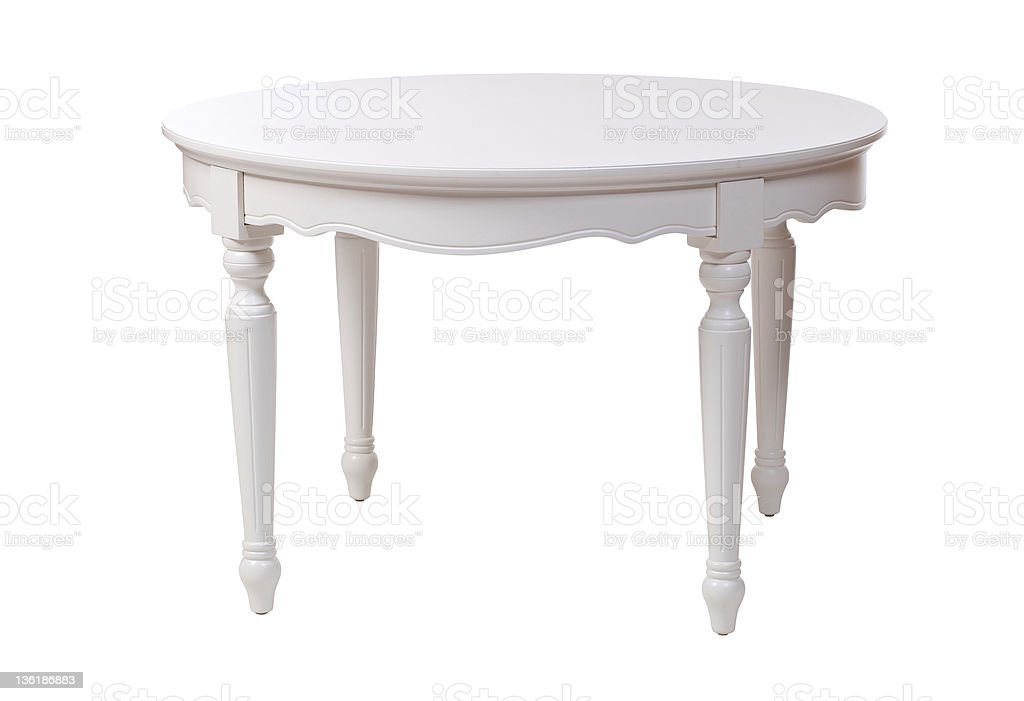 An elegant white table with intricate details stock photo
