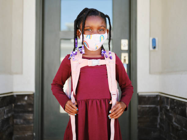 An Elementary School Student Going to School with Face Mask stock photo