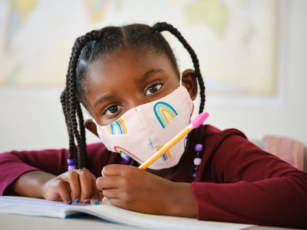 An Elementary School Student in a Classroom stock photo
