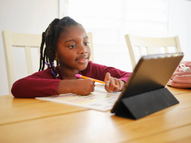 An Elementary School Student Working at Home stock photo