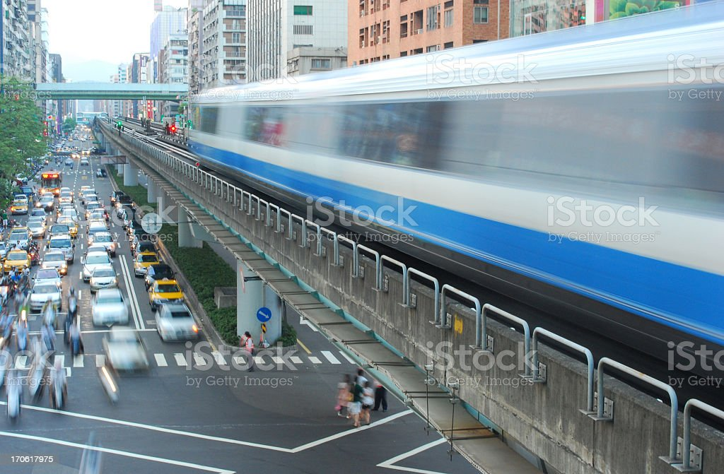 An elevated commuter train above traffic stock photo