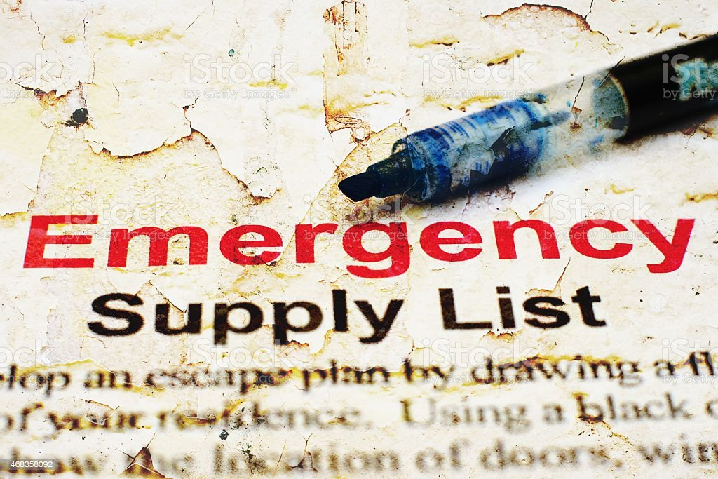 An emergency check list on torn, damaged paper royalty-free stock photo