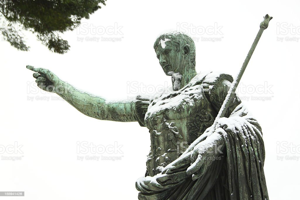 An emperor statue covered by snow stock photo
