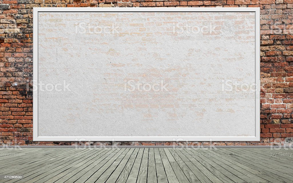 An empty billboard situated on a worn red brick wall stock photo