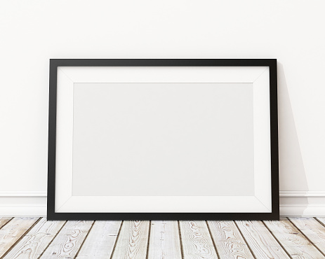 blank black horizontal picture frame on the wall and the floorblank black horizontal picture frame on the wall and the floor