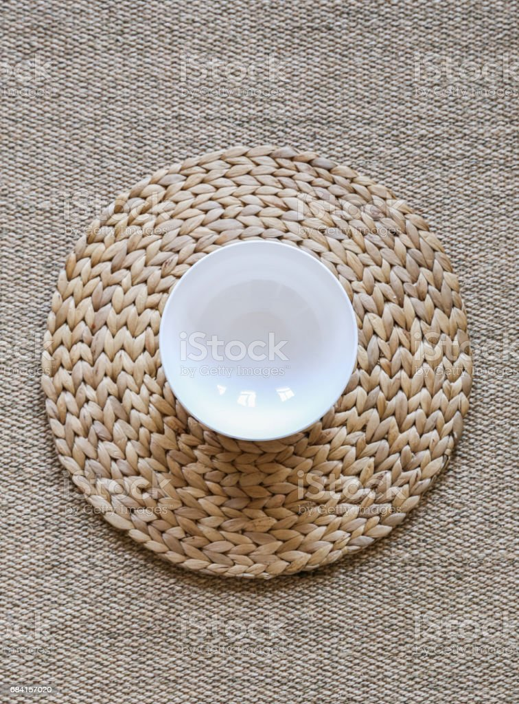 An Empty Bowl on the Table Mat royalty free stockfoto