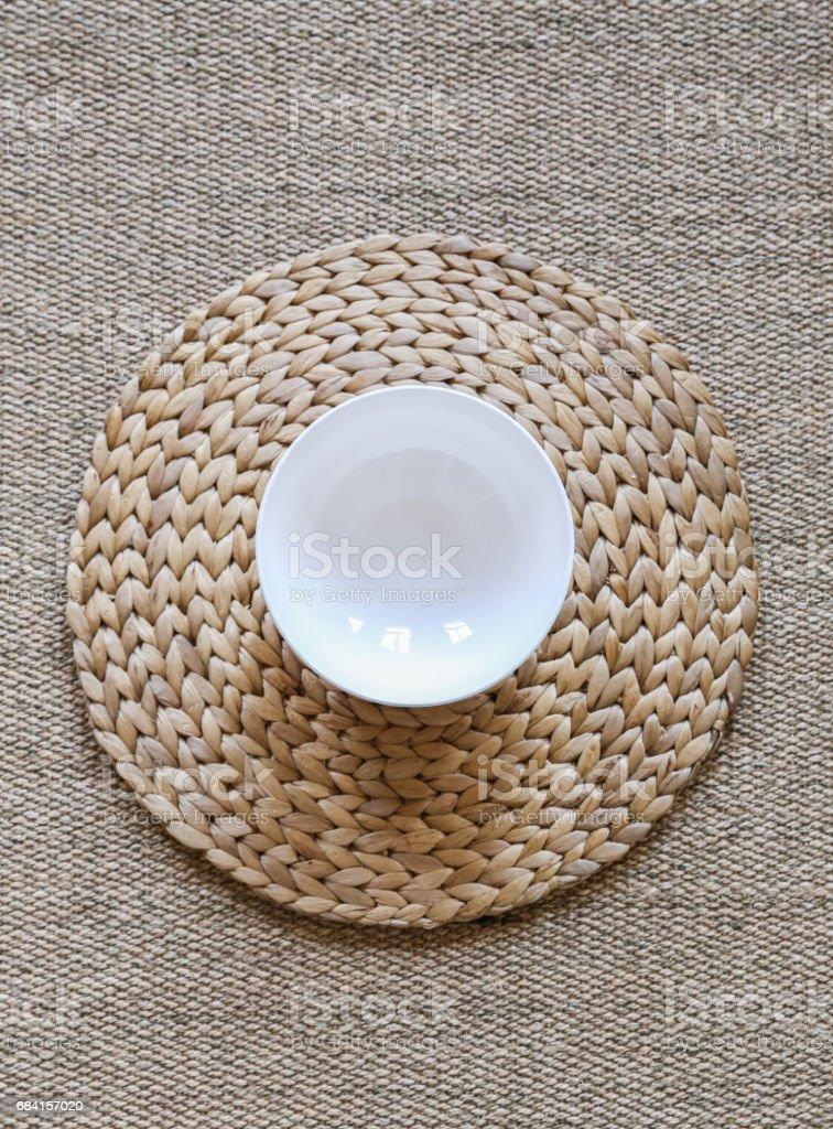 An Empty Bowl on the Table Mat zbiór zdjęć royalty-free