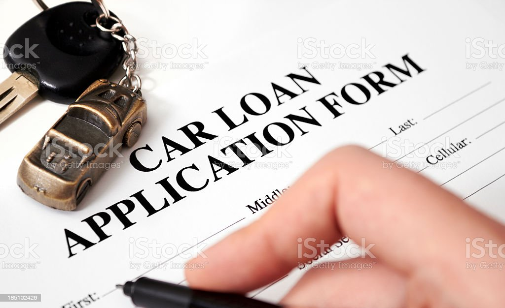 An empty car loan form with car key and a pen  royalty-free stock photo