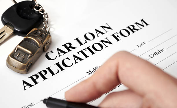 An empty car loan form with car key and a pen  stock photo