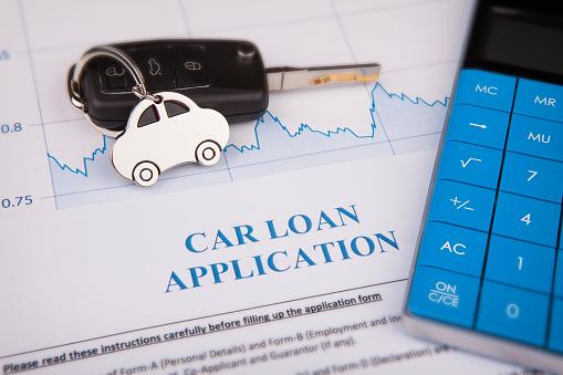 512011833 istock photo An empty car loan form with car key 1133438197