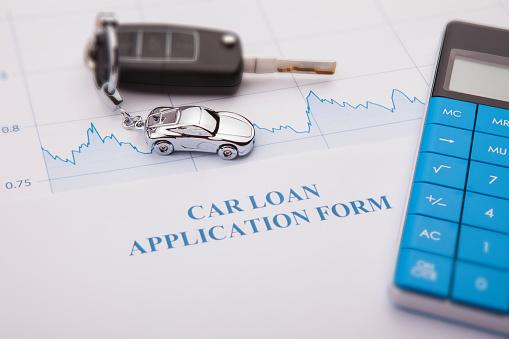 512011833 istock photo An empty car loan form with car key 1144220256