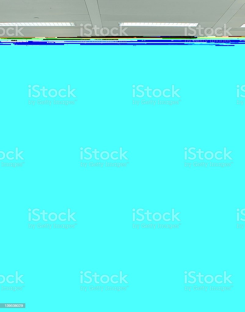An empty chair alone between two cubicle rows royalty-free stock photo