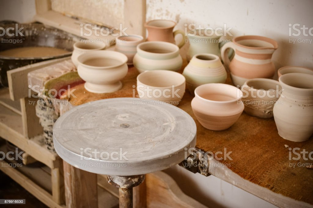 An empty circle, where the potter molds product close-up. Creative...