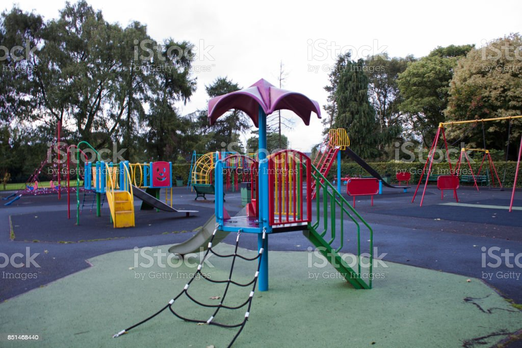 An empty Colourful children playground in the middle of the park stock photo