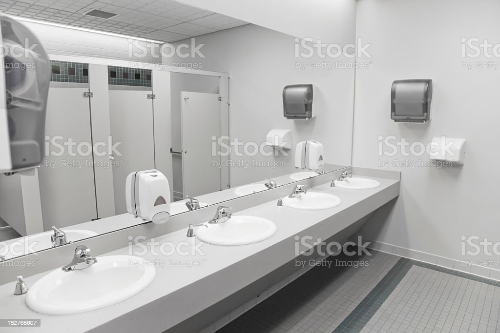 An empty commercial/public restroom stock photo