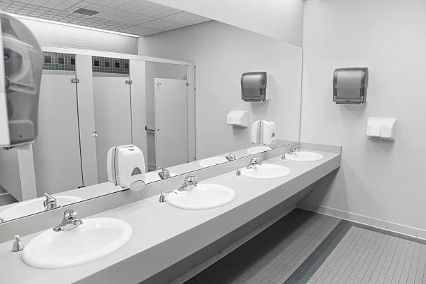 An Empty Commercial Public Restroom Stock Photo