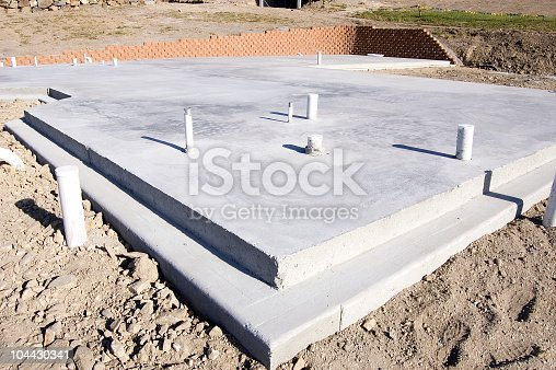 Picture of a concrete slab for a house.  Taken during the early morning.