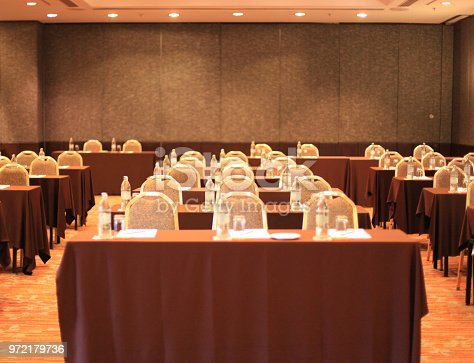 istock an empty conference meeting room in seminar hall with tables and chairs background 972179736