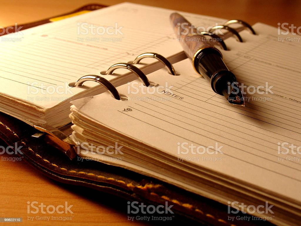 An empty diary with a pen lying down  royalty-free stock photo