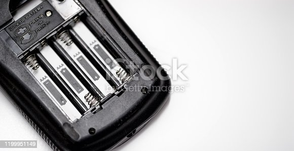 istock An Empty Electronic Device on a White Background without Four AAA Batteries Installed 1199951149