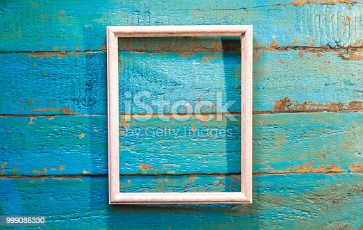 istock An empty frame for photos and images of white color 999086330