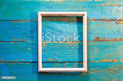 istock An empty frame for photos and images of white color 999086354