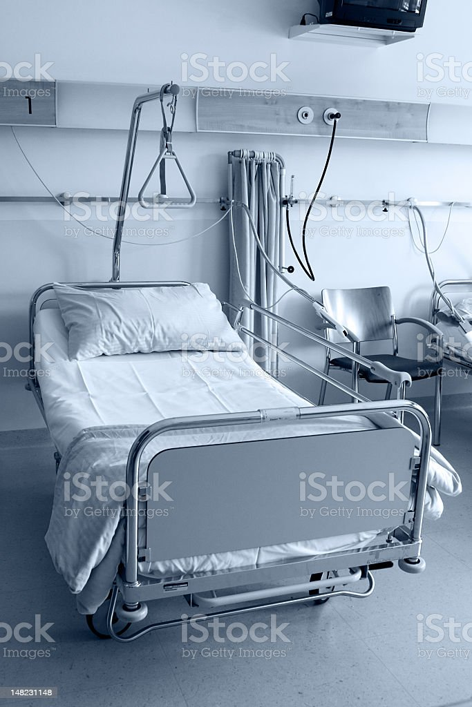 An empty hospital bed in a hospitals royalty-free stock photo