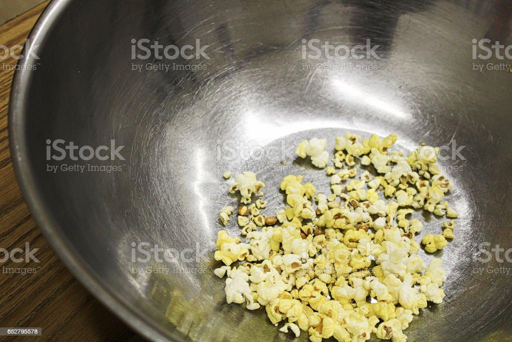 An empty metal popcorn bowl stock photo