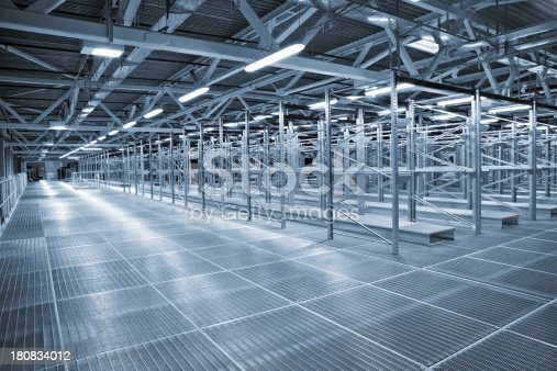 182889461 istock photo An empty metal storehouse with a lot of shelving 180834012