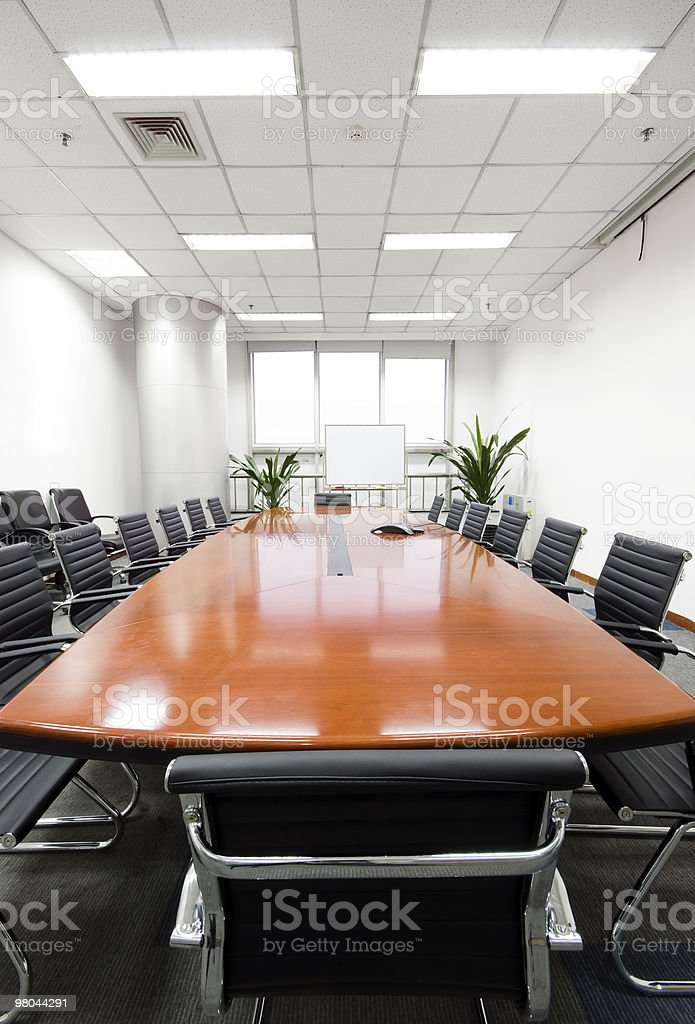 An empty, modern and clean boardroom table royalty-free stock photo
