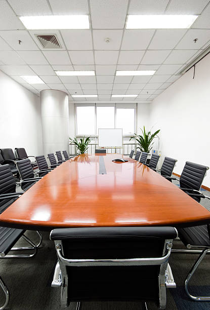 An empty, modern and clean boardroom table stock photo