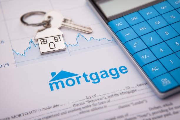 An empty mortgage application form with house key stock photo