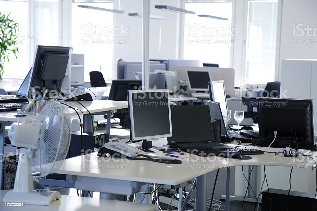 An empty office with desks and flat screen computers royalty-free stock photo