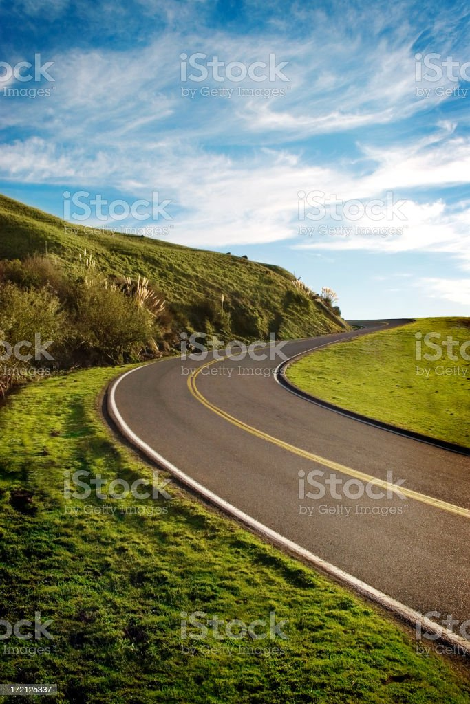 An empty road with the view of the hills and sky stock photo