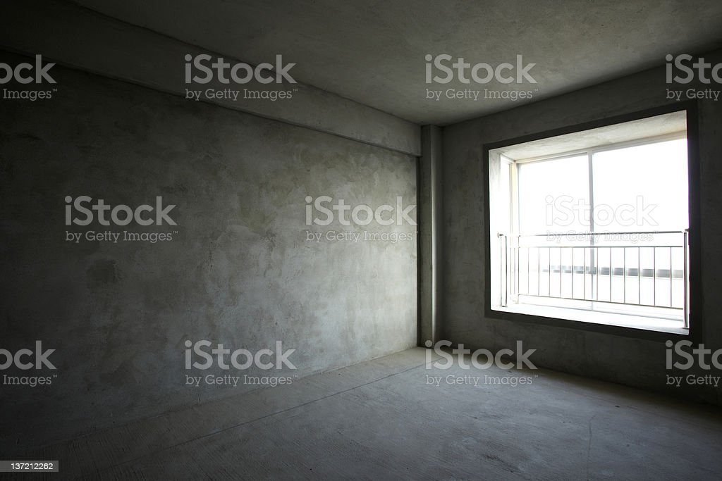 An empty room with a large window and a railing royalty-free stock photo